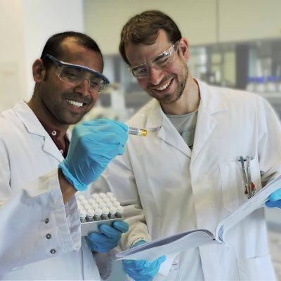 Research chemists collaborating in organic chemistry laboratory